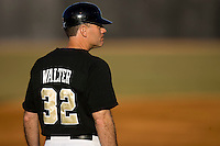 Wake Forest Demon Deacons head coach Tom Walter in the third base coaches box at the Wake Forest Baseball Park March 6, 2010, in Winston-Salem, NC.  Photo by Brian Westerholt / Four Seam Images