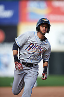 Akron RubberDucks shortstop Angel Miguel (7) running the bases during the second game of a doubleheader against the Bowie Baysox on June 5, 2016 at Prince George's Stadium in Bowie, Maryland.  Bowie defeated Akron 12-7.  (Mike Janes/Four Seam Images)