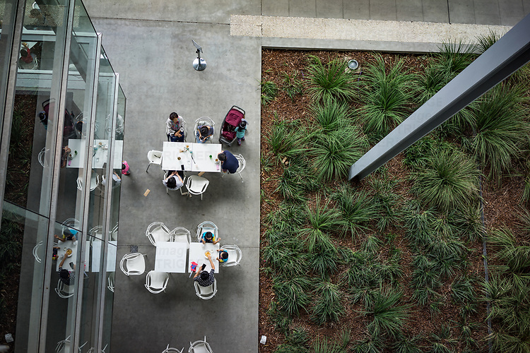 Families sitting at restaurant tables in the Art museum in Brisbane