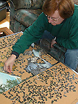 Woman assembling jig saw puzzle