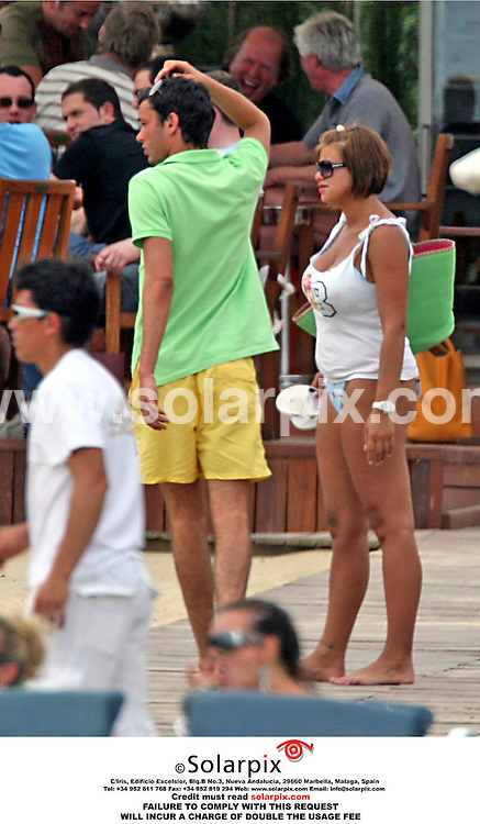 ALL-ROUND PICTURES FROM SOLARPIX.COM - 25.05.06.**MUST CREDIT SOLARPIX.COM OR DOUBLE USAGE FEE  CHARGED**.Ex Big Brother runner up, Jade Goody only had eyes for her new toyboy lover, 18 year old Jack Tweedy as they relaxed on a Marbella beach today. Jade couldn't keep her hands to herself as they swigged sangria in the hot Spanish sun. .REF: 2420 AB1