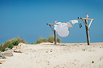 Clothesline on beach with american flags