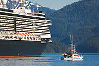 Commercial fishing vessel passes Holland America cruise ship Oosterdam, in Sitka Sound, Sitka, southeast, Alaska.