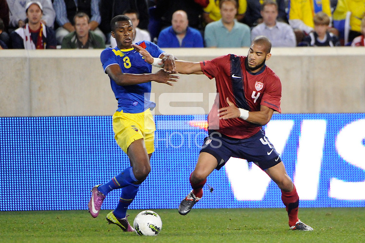 Oguchi Onyewu (4)  of the United States and Frickson Erazo (3) of Ecuador. The men's national team of the United States (USA) was defeated by Ecuador (ECU) 1-0 during an international friendly at Red Bull Arena in Harrison, NJ, on October 11, 2011.