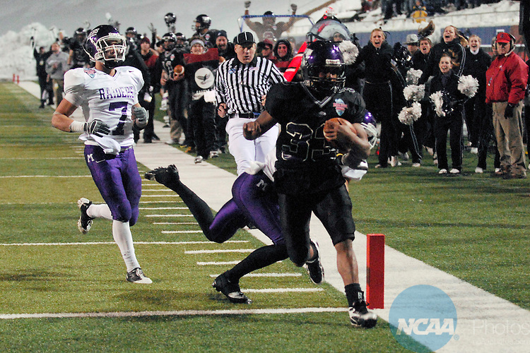 19 DEC 2009:  TB Levell Coppage (33) of the University of Wisconsin-Whitewater scores one of his three touchdowns against Mount Union College during the Division III Men's Football Championship held at Salem Stadium in Salem, VA.  Wisconsin-Whitewater defeated Mount Union 38-28 for their second national title.  Coppage was named the games MVP. Andres Alonso/NCAA Photos