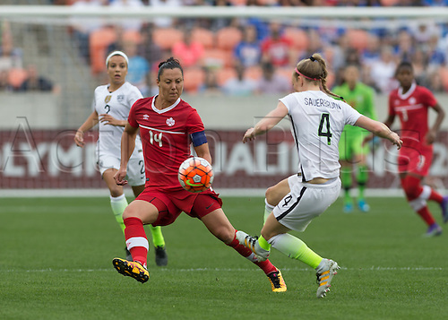 21.02.2016. Houston, TX, USA.  Canada Forward Melissa Tancredi (14)  and USA Defender Becky Sauerbrunn (4) during the Women's Olympic qualifying soccer final match between Canada and USA at BBVA Compass Stadium in Houston, Texas.