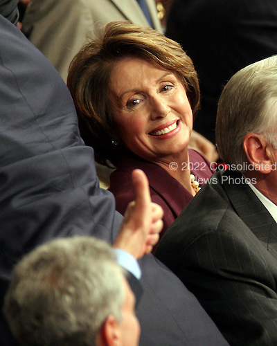 Washington, D.C. - January 4, 2007 --  United States Representative Nancy Pelosi (Democrat of the 8th District of California) smiles as she receives a thumbs-up from a Democratic colleague before she was sworn-in as the Speaker of the United States House of Representatives in the Capitol in Washington, D.C. on Thursday, January 4, 2007.  Speaker Pelosi is the first woman in U.S. history to serve in that position..Credit: Ron Sachs / CNP