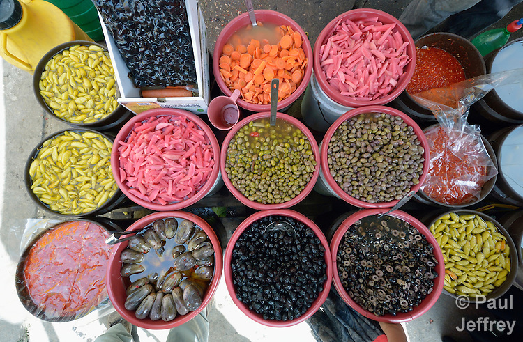 Olives and other foods on sale in the market in the Al-Shalti refugee camp in Gaza. Residents of the Palestinian territory are still reeling from the death and destruction of the 2014 war with Israel, and the continuing siege of the seaside territory by the Israeli military.