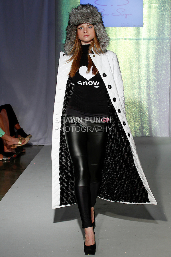 Model walks runway in an outfit from the Snow Sugar collection, during the SNOW Fashion NYC - Ski fashion show, June 11, 2013.
