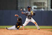 Tampa Yankees shortstop Jorge Mateo (14) turns a double play during a game against the Bradenton Marauders on April 15, 2017 at George M. Steinbrenner Field in Tampa, Florida.  Tampa defeated Bradenton 3-2.  (Mike Janes/Four Seam Images)