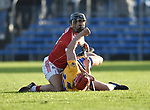 Eoin Cadogan of Cork  and Peter Duggan of Clare get tangled off the ball during their Munster Hurling League game at Cusack Park. Photograph by John Kelly.