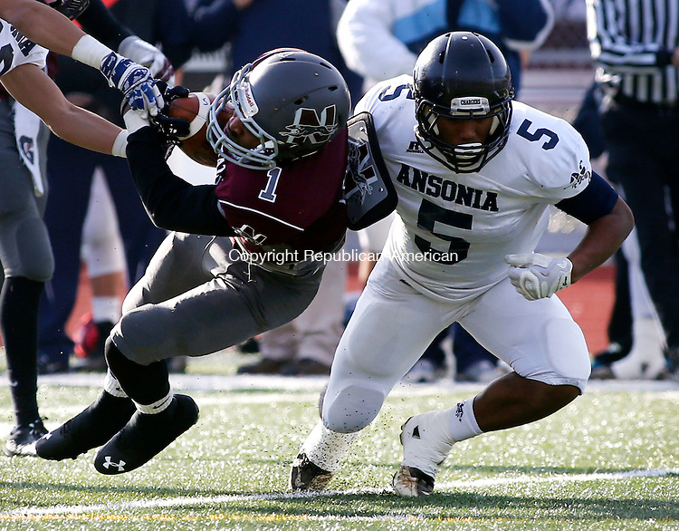 Naugatuck, CT- 26 November 2015-112615CM07-  Ansonia's Tyler Bailey (5) takes down Naugatuck's Antoine Sistrunk during their Thanksgiving matchup in Naugatuck on Thursday.  The Chargers would rout the Greyhounds,  41-8.   Christopher Massa Republican-American