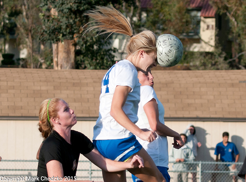 Santa Margarita's Machaela George knocks the air out of the ball as she heads it away from JSerra's Samantha Hobert in Tuesday's game.