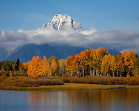 Mount Moran clears the clouds on this crisp fall day in Grand Teton National Park. Oxbow Bend, Grand Teton NP.