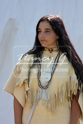 Native American Indian woman in front of a tipi