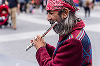 New York, NY 25 December 2015 - A flautist plays Jingle Bells on Christmas Day in Washington Square Park. Temperatures reached into the mid 60s on this unseasonably warm Christmas.