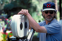 Jurassic Park (1993)<br /> American director Steven Spielberg poses with a Panaflex camera on the set of the film   <br /> *Filmstill - Editorial Use Only*<br /> CAP/KFS<br /> Image supplied by Capital Pictures