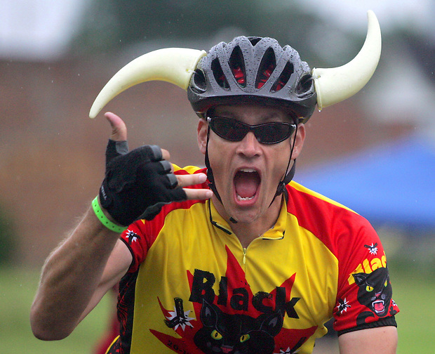 A horned rider gives a salute on the way out of Chelsea on RAGBRAI XXXVI.