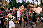 Chelsea Flowers Show last day taking home flowers sold cheaply at the end of the show London Uk 1986