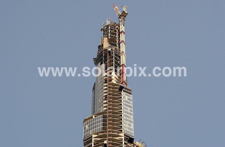 **ALL ROUND PICTURES FROM SOLARPIX.COM**.**WORLDWIDE SYNDICATION RIGHTS**.Burj Dubai is a skyscraper under construction in Dubai, United Arab Emirates, and is the tallest man-made structure on Earth, despite being incomplete. Construction began on September 21, 2004, and it is expected to be completed and ready for occupation in September 2009. Dubai, United Arab Emirates. July 2008  ...This pic: Burj Dubai..JOB REF: 8295 DBL     DATE: 20_07_2008.**MUST CREDIT SOLARPIX.COM OR DOUBLE FEE WILL BE CHARGED* *ONLINE USAGE FEE £50.00 PER PICTURE - NOTIFICATION OF USAGE TO PHOTO@SOLARPIX.COM*