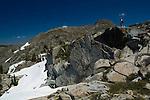 Hiker atop alpine granite rocks, Desolation Wilderness, El Dorado National Forest, California
