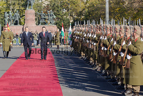 Nikola Gruevski (L) Prime Minister of Macedonia and his counterpart Viktor Orban (R) inspect the guard of honor during a welcoming ceremony in Budapest, Hungary on November 14, 2012. ATTILA VOLGYI