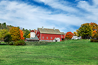 Charming hillside farm with red barn, Woodstock, Vermont, USA.