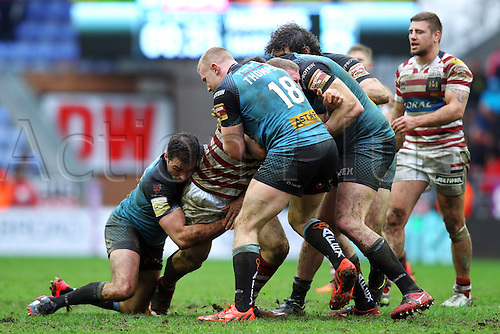 03.04.2015.  Wigan, England.  Super League Rugby. Wigan Warriors versus St Helens. Luke Thompson of St Helens and Alex Walmsley of St Helens try to repel the Wigan attack