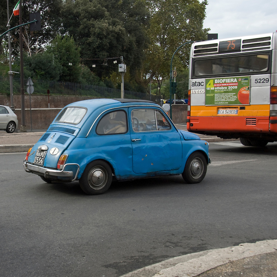 fiat 500 still driving in rome, italy,