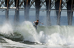 JAN 24: Surfer catches a wave at the Oceanside Pier on Jan 24, 2011. Photo by Donald Miralle