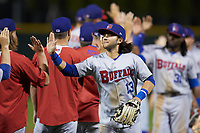 Bo Bichette (13) of the Buffalo Bisons slaps hands with his teammates following their win over the Charlotte Knights at BB&T BallPark on July 24, 2019 in Charlotte, North Carolina. The Bisons defeated the Knights 8-4. (Brian Westerholt/Four Seam Images)