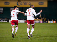 Thierry Henry (14) and Tim Cahill (17) of New York Red Bulls celebrate a goal during the game at RFK Stadium in Washington DC. D.C. United tied New York Red Bulls, 1-1.