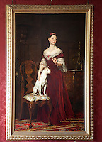 A portrait of Lady Theodora Merthyr Guest and her dog hangs in the red dining room