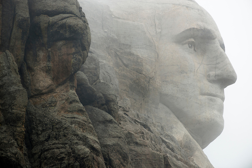 Clouds hang over the bust of President George Washington at Mount Rushmore National Memorial.