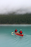 Paddling on Maligne Lake in Jasper National Park, Alberta, Canada on a misty morning.