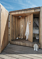 A partially outdoor shower is accessed from the sleeping cabin