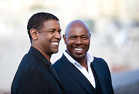 "Actor Denzel Washington (L) and director Antoine Fuqua attend a pohotocall to promote their film ""The Equalizer"" during the 62nd San Sebastian Film Festival on September 19, 2014, Basque country. (Ander Gillenea / Bostok Photo)"