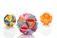 New York, NY, USA - November 4, 2011: Three Ishibashi balls designed by Japanese Origami artist Minako Ishibashi. Each piece is folded from multiple pieces of colored paper by Esme Cribb.