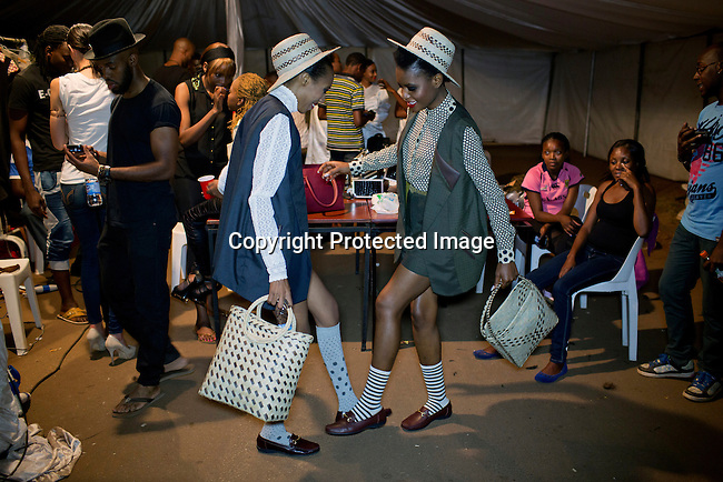 HARARE, ZIMBABWE - SEPTEMBER 27: Models wait backstage before a fashion show with the designer Haus of Stone on September 27, 2014 at the Harare City library in Harare, Zimbabwe. Local and African and based designers showed their collections during the 5th edition of Zimbabwe Fashion week (Photo by: Per-Anders Pettersson)