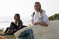 Pacific Beach, San Diego CA, USA.  Wednesday, January 9 2013:  Members of the PB Locals Surf Club, Ciara Gray and Kiely Knight from PB Middle School pose near tower 27 before heading out into the water for an afternoon training session.  The after school team meets every Wednesday about two hours before sunset to train for weekend competitions.