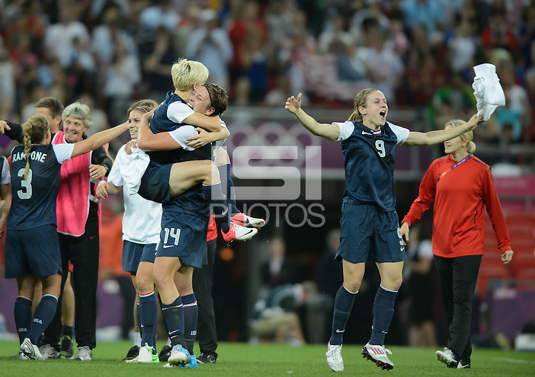 London, England - Thursday, August 9, 2012: The USA defeated Japan 2-1 to win the London 2012 Olympic gold medal at Wembley Arena. Abby Wambach, Megan Rapinoe, and Heather O'Reilly celebrate the USA victory. .