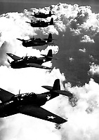 TBF (Avengers) flying in formation over Norfolk, Va.  September 1942.  Attributed to Lt. Comdr. Horace Bristol.  (Navy)<br /> Exact Date Shot Unknown<br /> NARA FILE #:  080-G-427475<br /> WAR &amp; CONFLICT BOOK #:  962