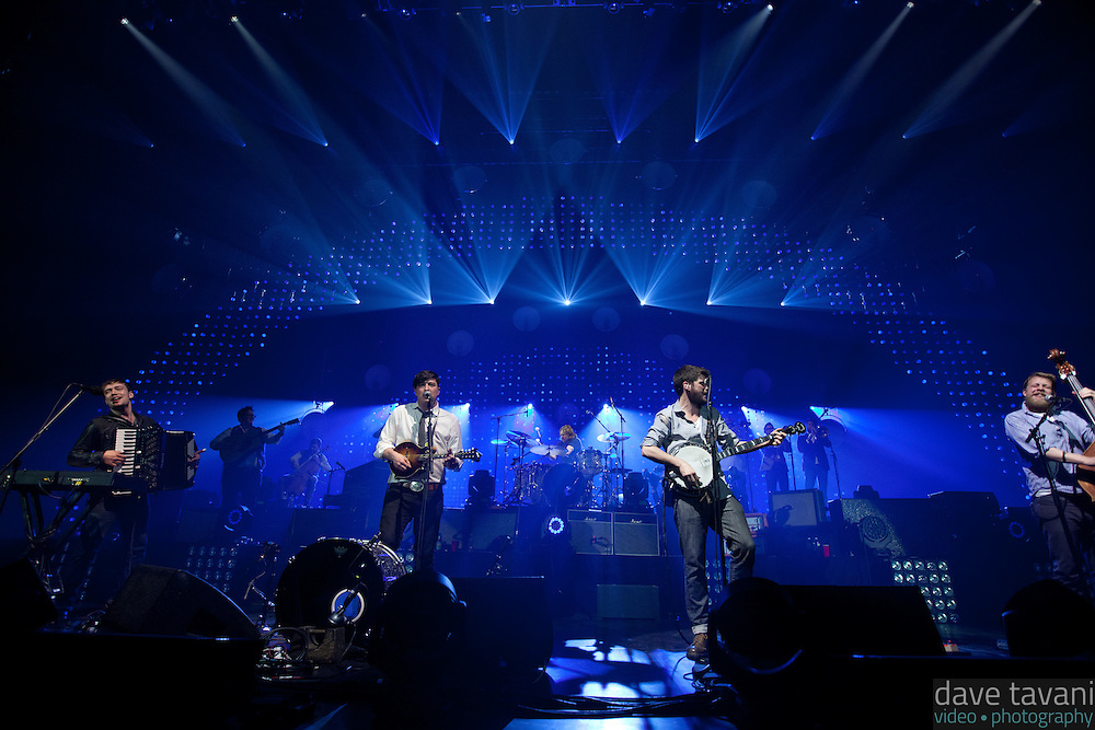"Mumford & Sons (Ben Lovett, Marcus Mumford, Winston Marshall, and Ted Dwane) perform ""Winter Winds"" during a live concert at the Susquehanna Bank Center in Camden, New Jersey, February 16, 2013."