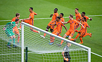 Holland celebrate after Ramon Hendriks (2nd left) scores his penalty to crown them champions (4-1 on penalties) during the UEFA Under-17 Championship FINAL match between Italy and Netherlands at the New York Stadium, Rotherham, England on 20 May 2018. Photo by Andy Rowland.