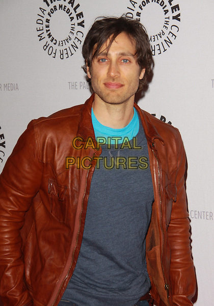 "BRAD FALCHUK.27th Annual Paley Fest  presents  ""Glee""  held at the Saban Theatre, Beverly Hills, California, USA..March 13th, 2010.half length  blue top brown leather jacket turquoise grey gray  .CAP/ADM/TC.©T. Conrad/AdMedia/Capital Pictures."