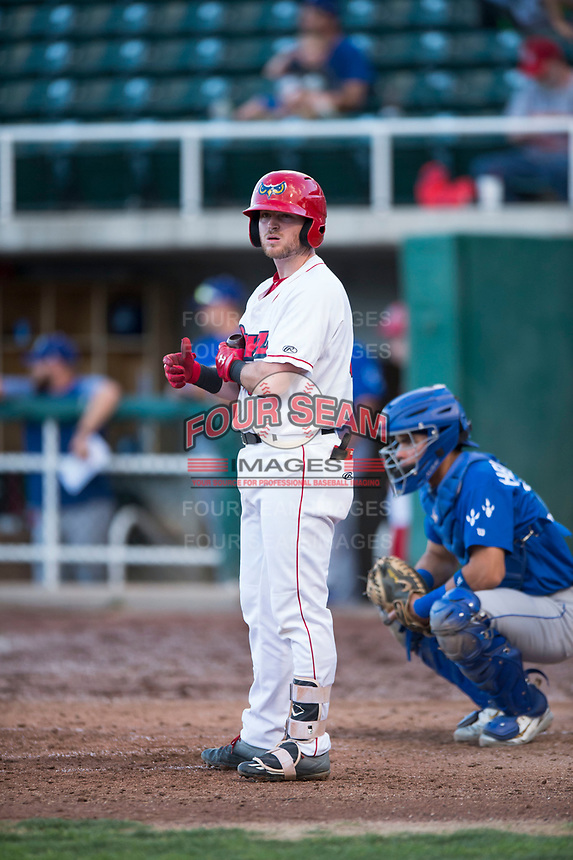 Orem Owlz second baseman Justin Jones (33) at bat in front of catcher Marco Hernandez (38) during a Pioneer League game against the Ogden Raptors at Home of the OWLZ on August 24, 2018 in Orem, Utah. The Ogden Raptors defeated the Orem Owlz by a score of 13-5. (Zachary Lucy/Four Seam Images)