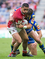 Picture by Allan McKenzie/SWpix.com - 13/07/2017 - Rugby League - Betfred Super League - Wigan Warriors v Warrington Wolves - DW Stadium, Wigan, England - Wigan's Willie Isa fends off Warrington tacklers.