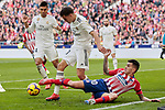 Atletico de Madrid's Angel Martin Correa and Real Madrid's Sergio Reguilon during La Liga match between Atletico de Madrid and Real Madrid at Wanda Metropolitano Stadium in Madrid, Spain. February 09, 2019. (ALTERPHOTOS/A. Perez Meca)