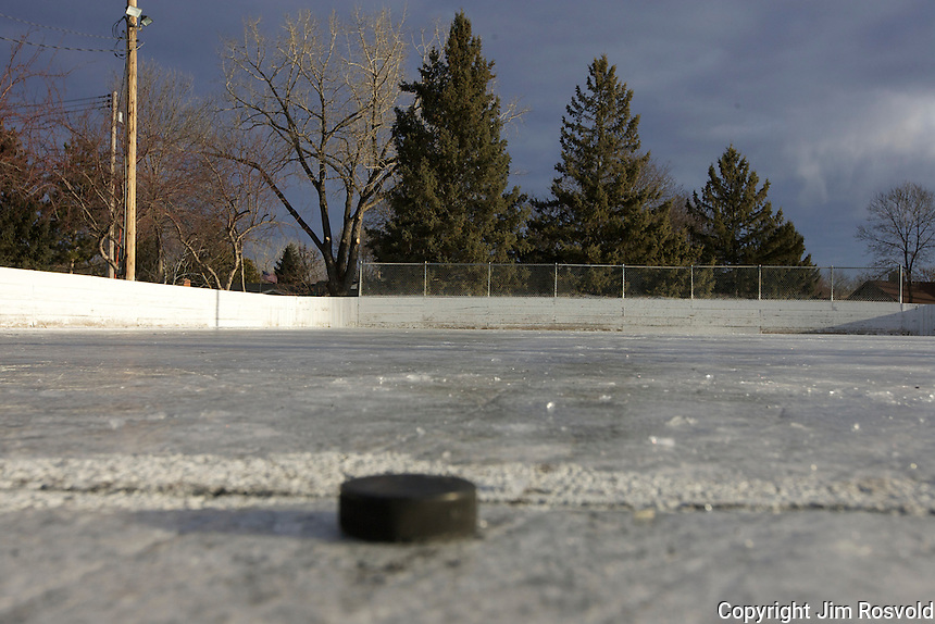 7 Jan 12: Mild weather takes it's toll on the rink in Friendly Hills Park in Mendota Heights, MN.  Only an abondoned puck and net remain on partial ice.