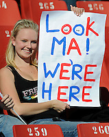 A female USA football fan lets her parents know she has safely arrived in South Africa